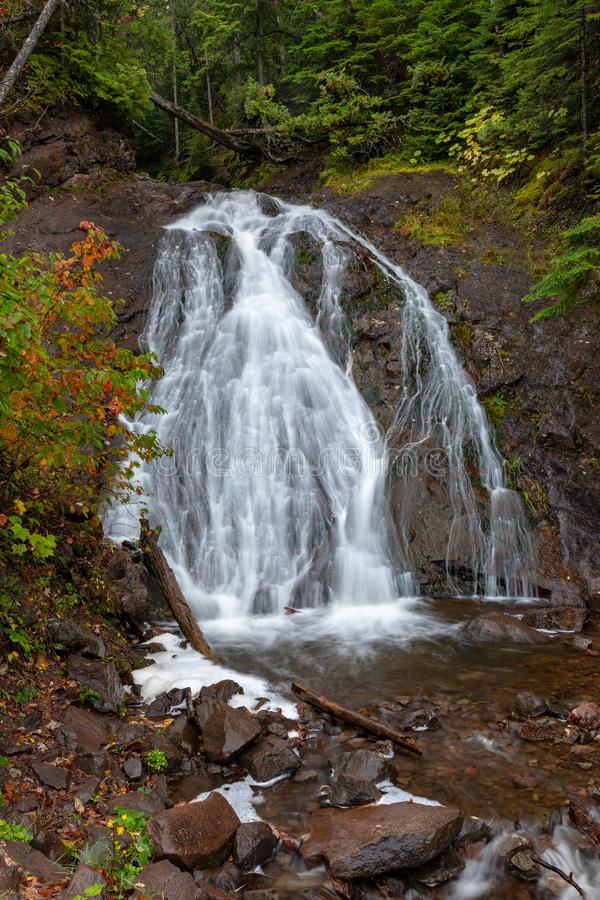 Jacobs Fall and Jacobs Creek in Michigan`s Upper Peninsula, USA. Cascading water flows rapidly over Jacob's Falls near Eagle River Michigan. Autumn colors stock photos