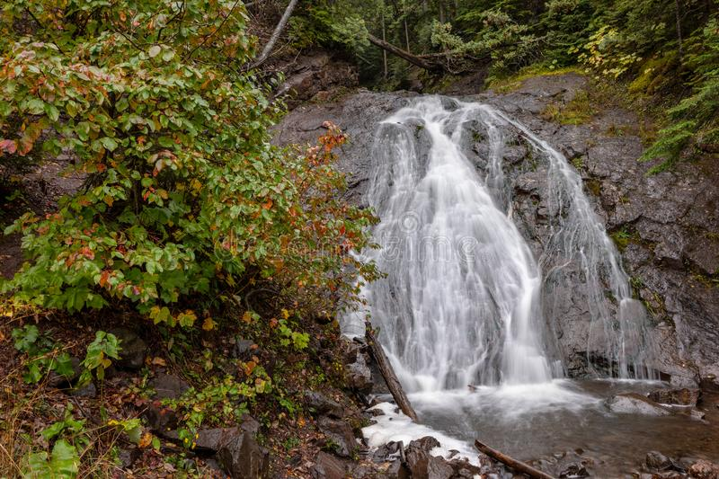 Jacobs Falls in Autumn, waterfall in northern Michigan, USA. Cascading water flows rapidly over Jacob's Falls near Eagle River Michigan. Autumn colors and royalty free stock photography