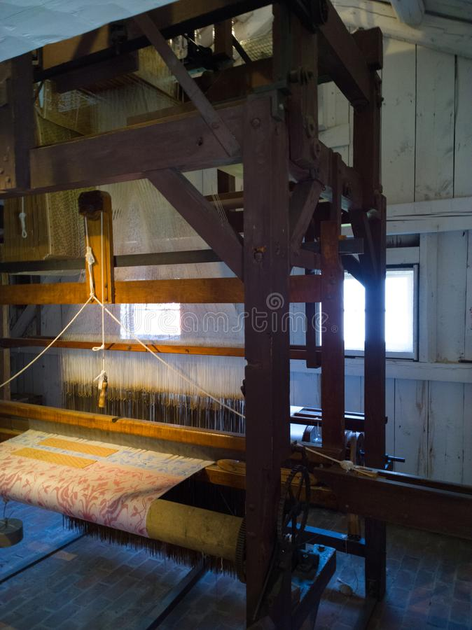 Jacquard Loom. Treadle operated loom circa 1886 that utilized cards with punched holes similar to early computer punch cards in which each card corresponded to a stock image