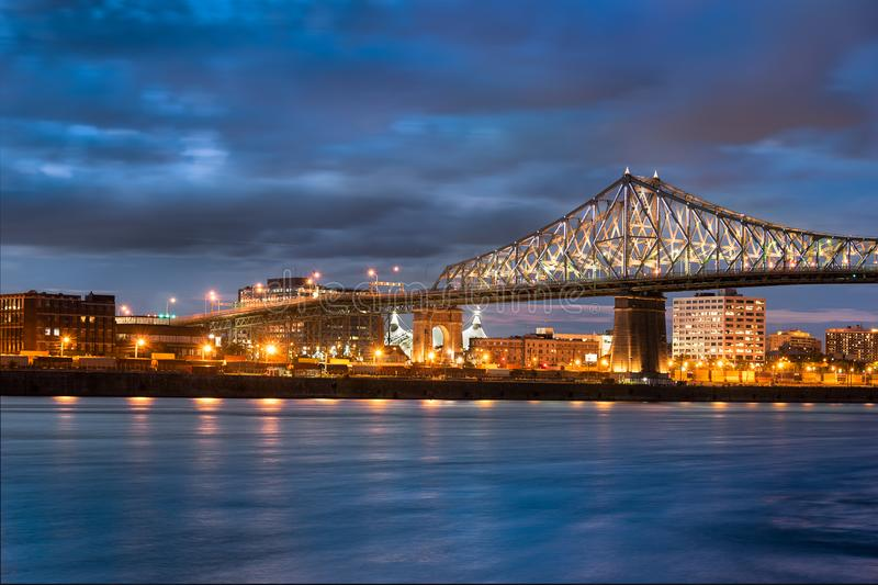 Jacques Cartier Bridge in Canada. Jacques Cartier Bridge Illumination in Montreal, reflection in water. Montreal's 375th anniversary. luminous colorful royalty free stock image