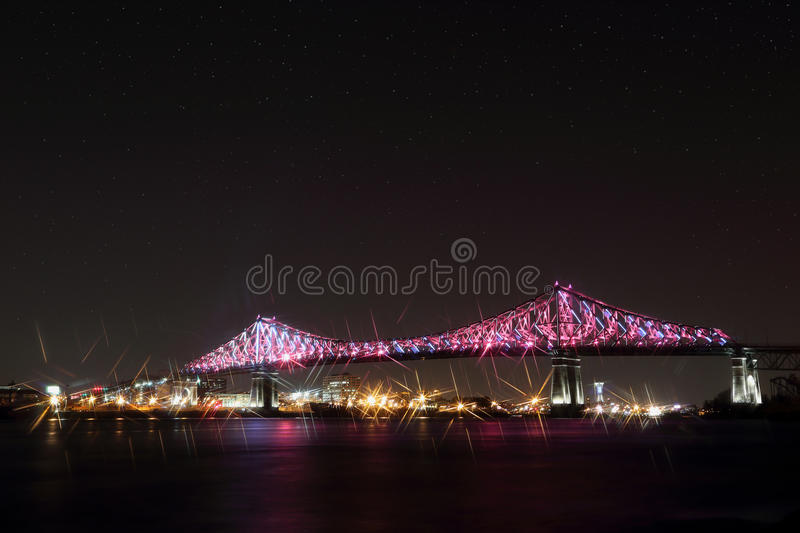 Jacques Cartier Bridge Illumination in Montreal, reflection in water. Montreal's 375th anniversary. Luminous colorful interactive Jacques Cartier Bridge royalty free stock images