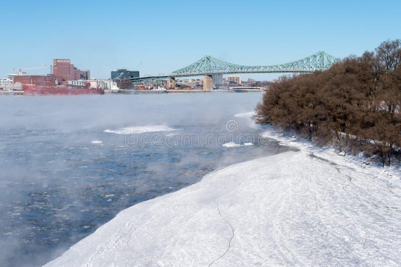 Jacques Cartier bridge and Parc Jean Drapeau in winter stock photography