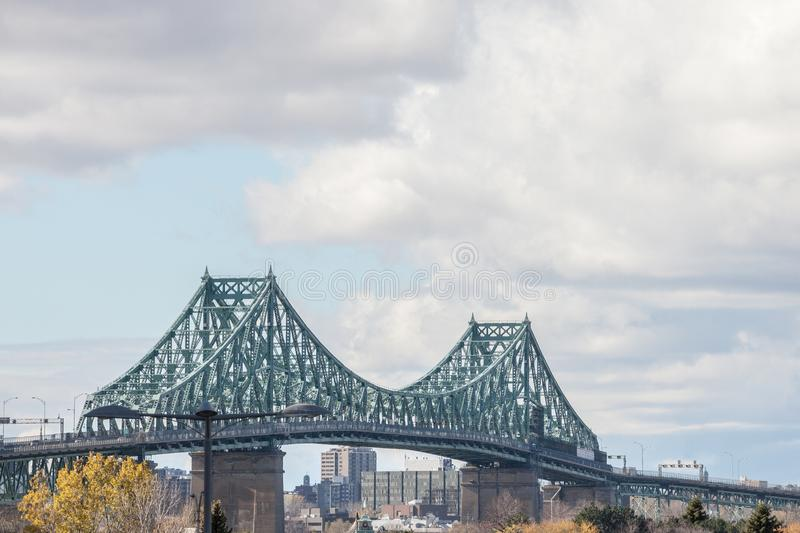 Pont Jacques Cartier bridge taken in Longueuil in the direction of Montreal, in Quebec, Canada, during a cloudy afternoon. stock images