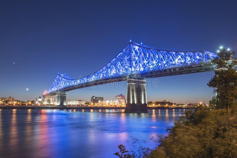Jacques Cartier-brug bij schemer stock fotografie