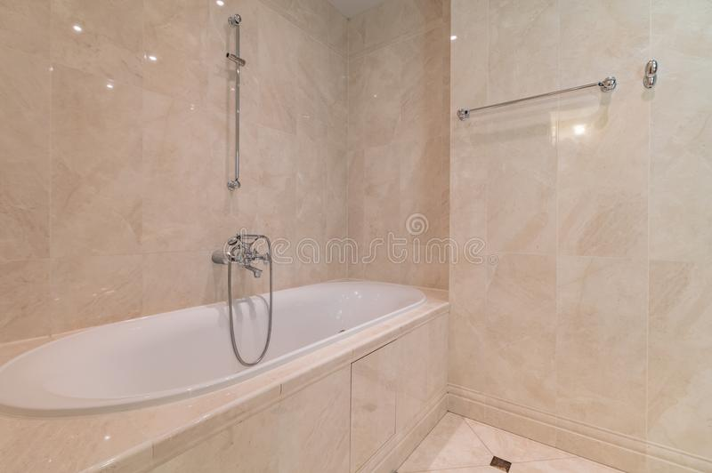Jacuzzi bath tube. New empty jacuzzi bath tube in bathroom interior stock photo