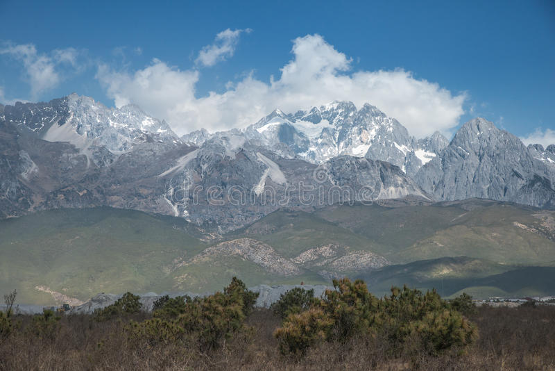 Jade Dragon Snow Mountain in cloud.  royalty free stock photography