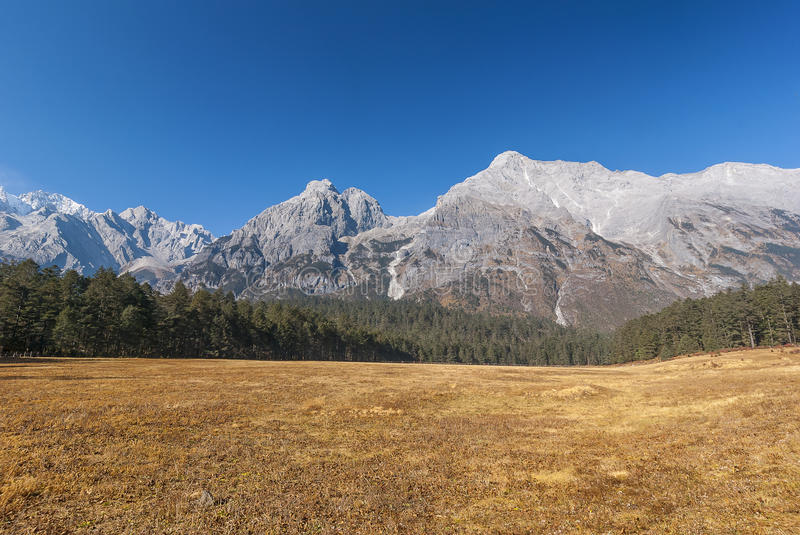 Jade Dragon snow mountain. Over blue sky stock images
