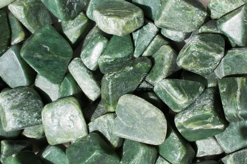 Jade gem stone as natural mineral rock. Specimen royalty free stock image