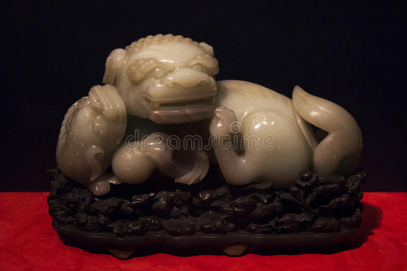 Jade mother lion and lion cubs stock images