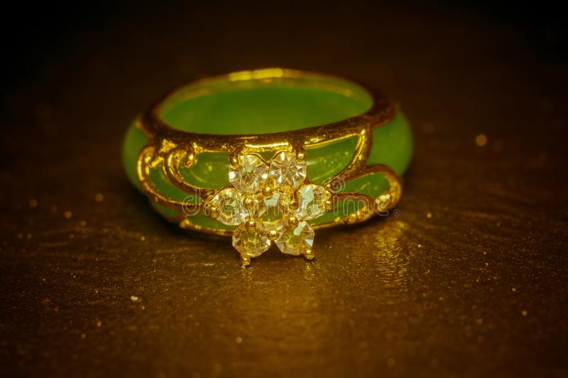 Jade Ring with Diamonds. Green jade ring decorated with diamonds and gold setting royalty free stock image
