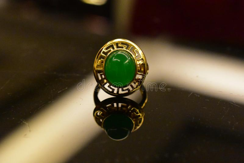 Jade ring Is a gold ring decorated with jade and genuine stock image