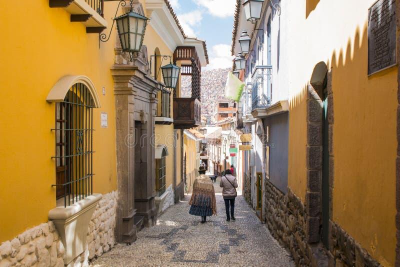 Jaen Street in La Paz, Bolivia city center. On a bright summer day. Cholita walking down the street stock photography