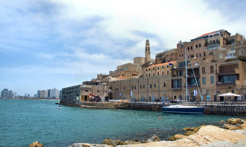 Jaffa Israel by the sea. Old Jaffa city in Israel by the sea with many old buildings by the harbour and modern buildings far in background stock image