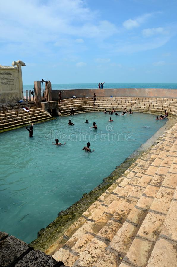 Keerimalai fresh water spring tank by ocean water Jaffna Sri Lanka. Jaffna, Sri Lanka - February 19, 2017: A bathing tank full of boys in Keerimalai, Jaffna stock image