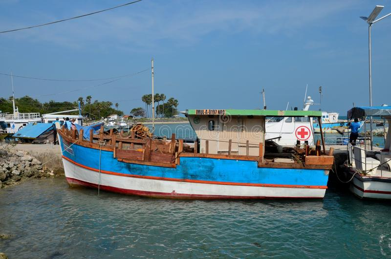 Boats tied to shore at port harbor on Palk Strait near Jaffna Sri Lanka royalty free stock photography