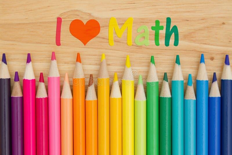 Jag älskar matematikmeddelandet med blyertspennafärgpennor royaltyfria foton