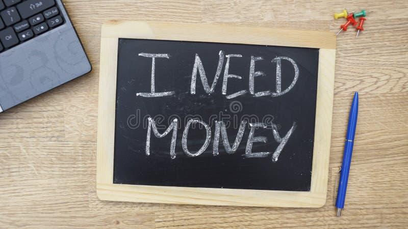 Jag behöver skriftliga pengar arkivfoto