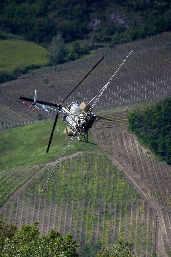 jaga helikoptersprej arkivfoto