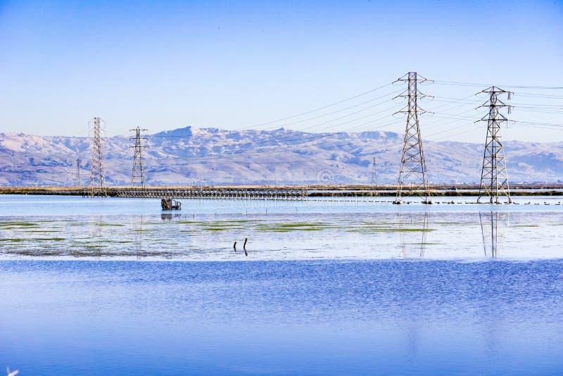 Jagd von Vorhängen und von StromStromleitungen, Moffett-Spur, Süden San Francisco Bay, Kalifornien stockfotos