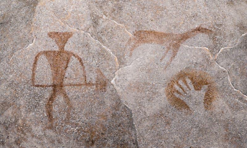 Jager, dier, hand geschilderde oker op de muur van het hol door een oude mens oude beelden royalty-vrije stock foto
