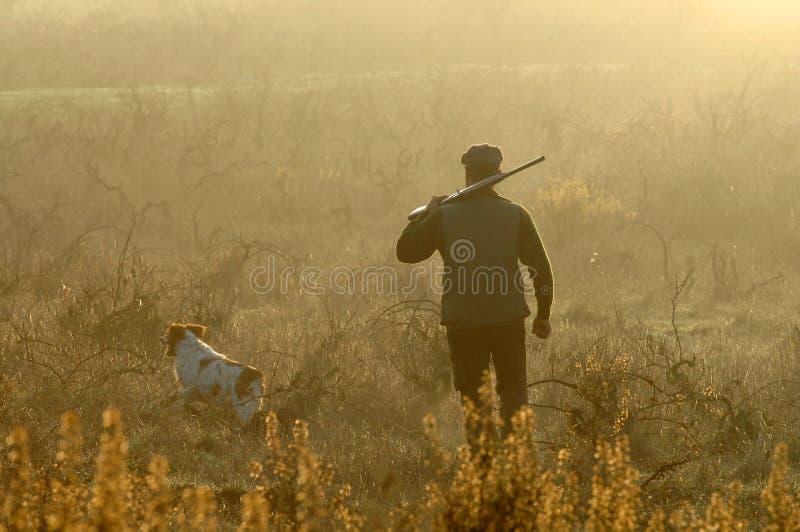 Jager en zijn hond royalty-vrije stock foto