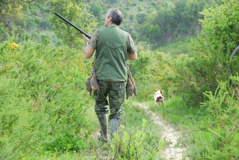 Jager en zijn hond royalty-vrije stock foto's