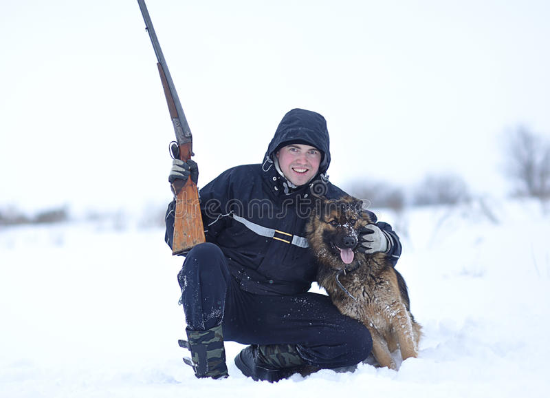 Jager met Zijn Hond stock foto