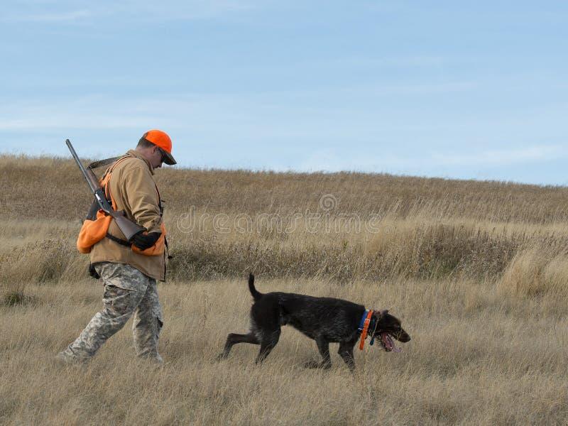 Jager op de prairie stock afbeelding
