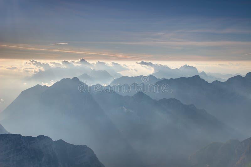 Jagged blue ridges and hazy Trenta valley Julian Alps Slovenia. View from Triglav summit with serrated blue ridges of Julijske Alpe Alpi Giulie range and Bavski stock photography