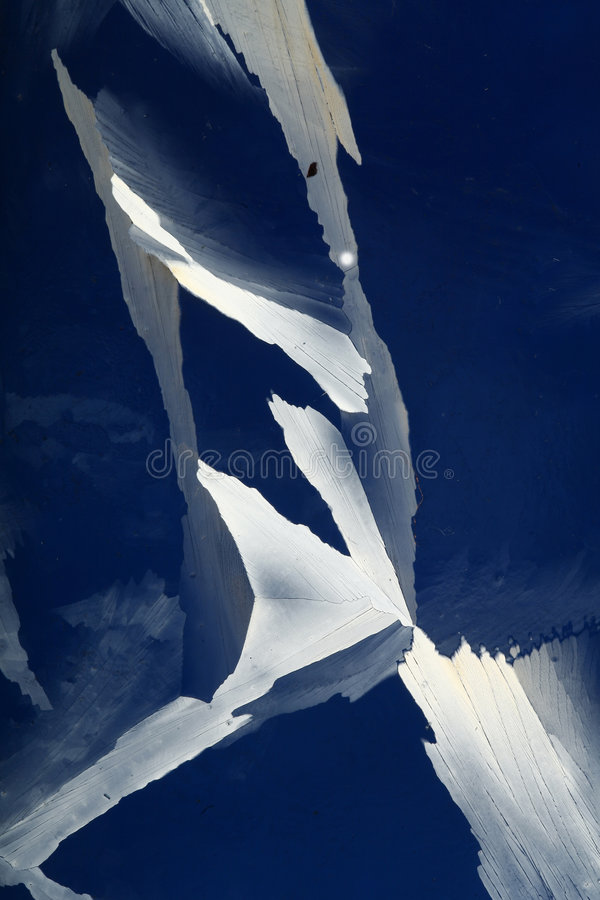Jagged Ice Crystals. An imaged of the jagged edges of ice crystals on a blue background stock photos