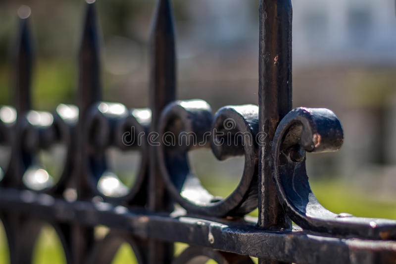 Jagged iron fence with blurry background. In Athens, Greece stock photos