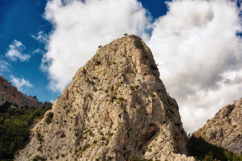 Omis Croatia karst mountains. Jagged karst mountains abut the sea on the Croatian coast near Omis, south of Split stock images