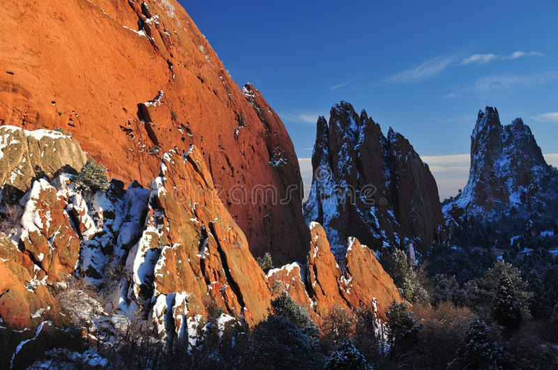 Jagged mountains. Jagged snow covered mountains against blue sky royalty free stock images