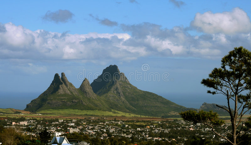 Jagged peaks. Very sharp and jagged mountain peaks on the tropical island of Mauritius stock photo