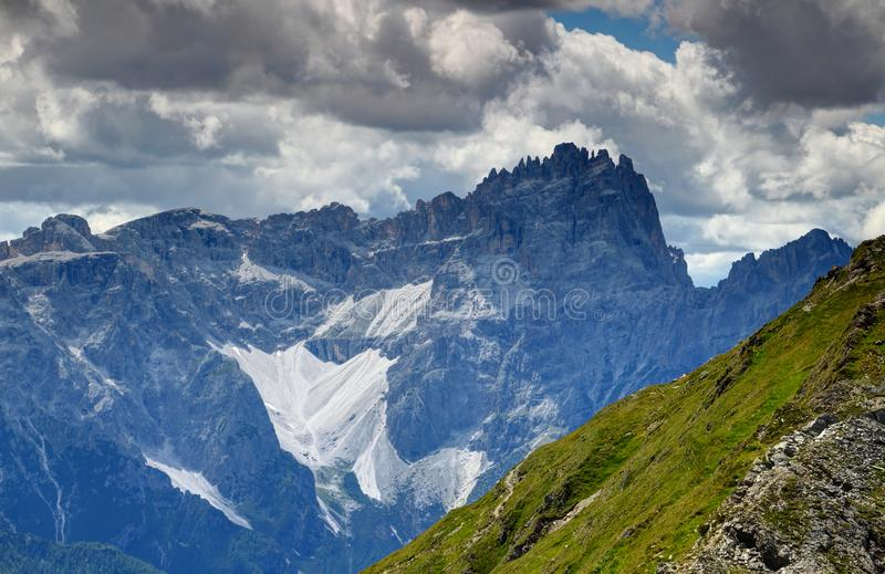 Jagged peaks of Sexten Dolomites from grassy Carnic Alps Italy royalty free stock photo