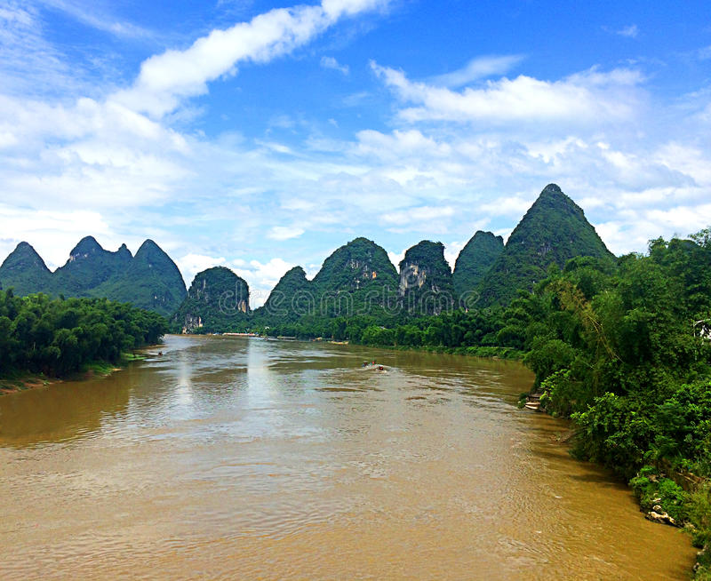 The jagged peaks of Yangshuo along the Li River in Southern China. The jagged and verdant peaks of Yangshuo reflecting on the Li River in Southern China stock images
