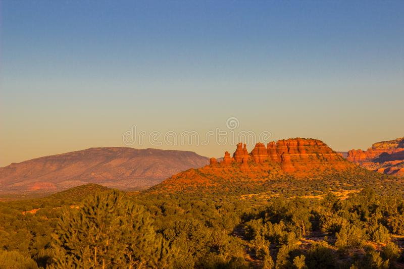 Jagged Red Rock Outcroppings Overlooking Valley stock photo