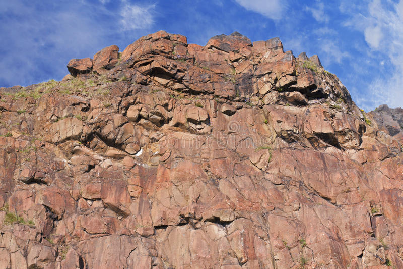 Jagged rocks. Jagged red rocks at Holyrood park in Edinburgh, Scotland royalty free stock image