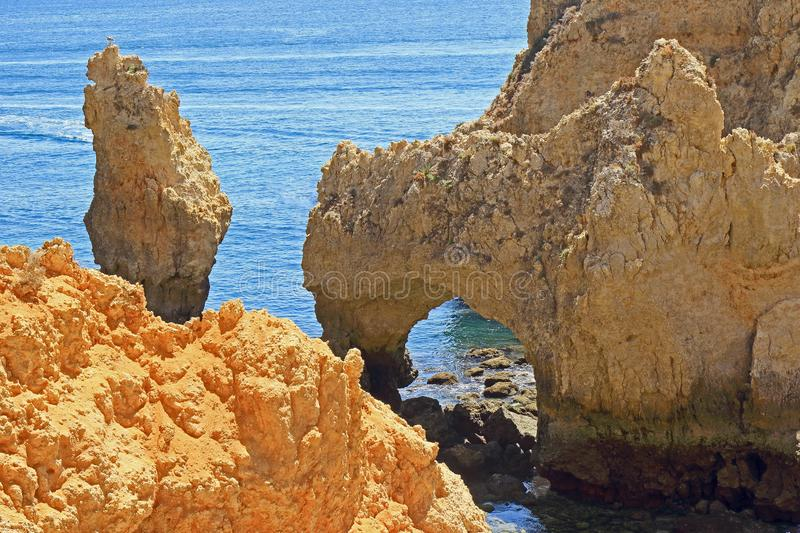 Jagged rocky cliffs and limestone archways stock image