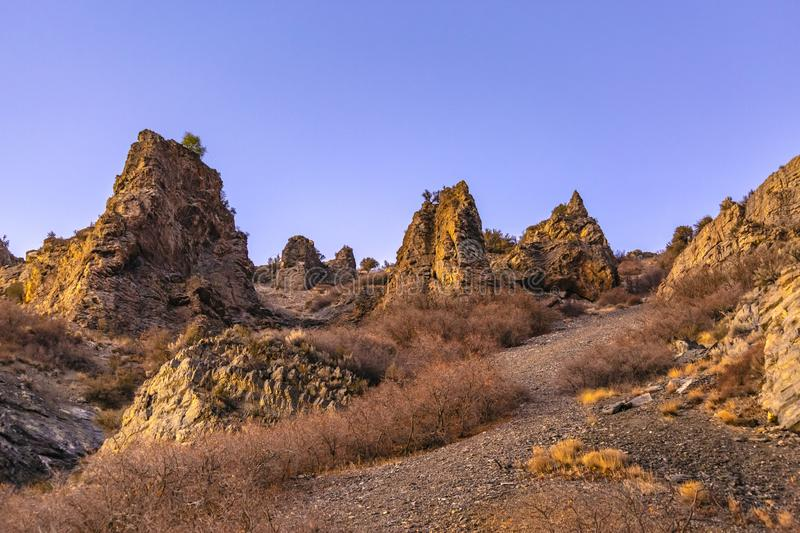 Jagged and rocky mounds on the side of a mountain stock photography