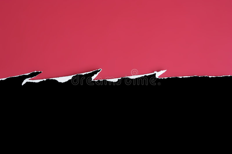 Jagged tear. Black card jagged tear on a red background royalty free stock photo