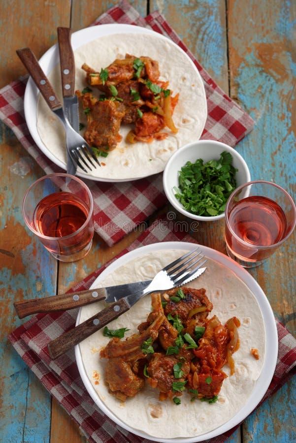 Jagnięcy kotleciki z pomidorem i pieprzem zdjęcie royalty free