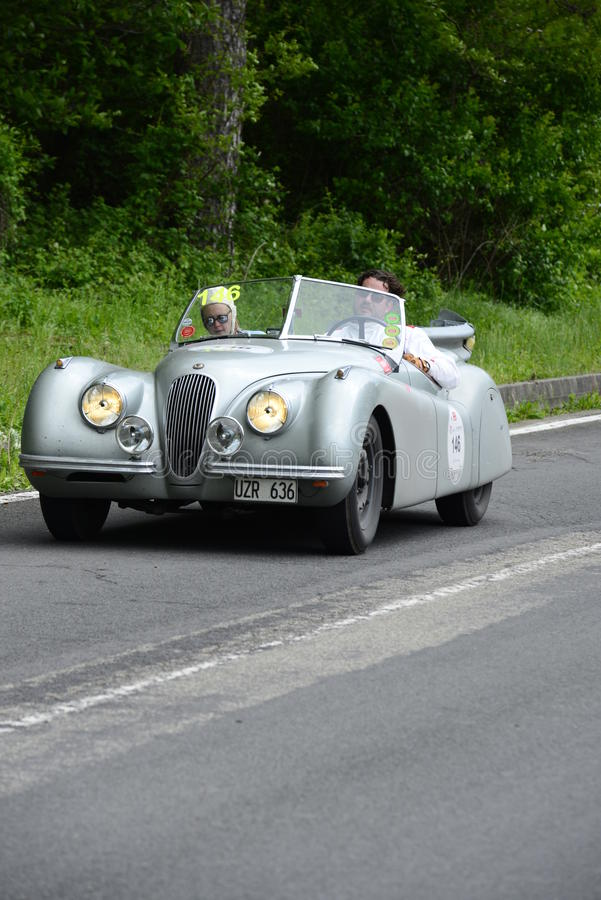 Jaguar car running in Mille Miglia race stock photography