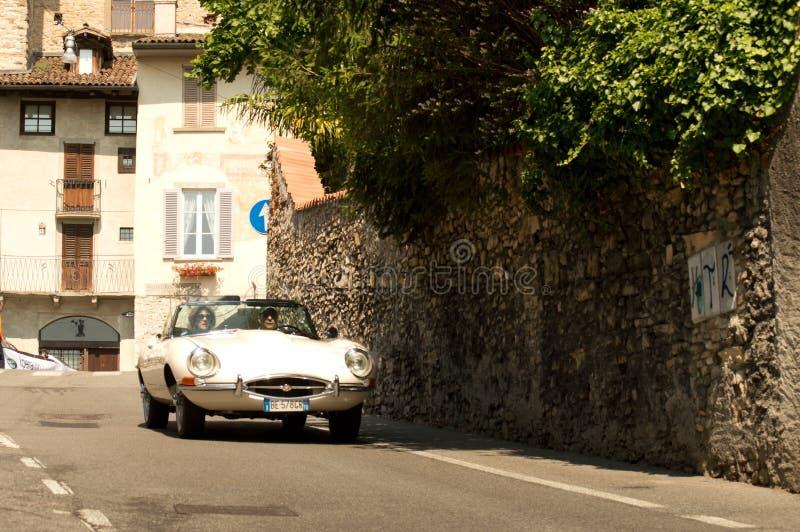 Jaguar E-Type at Bergamo Historic Grand Prix 2017. A Jaguar E-Type going down trough Boccola street in Citta` Alta the medieval part of Bergamo during the 2017 royalty free stock images