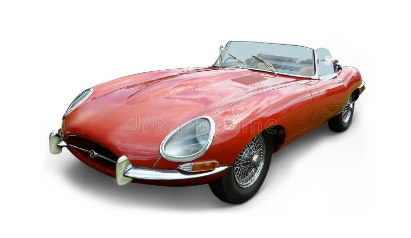 Jaguar E-type. Red classic Jaguar E-type sports car with wire wheels, soft top and white background royalty free stock images