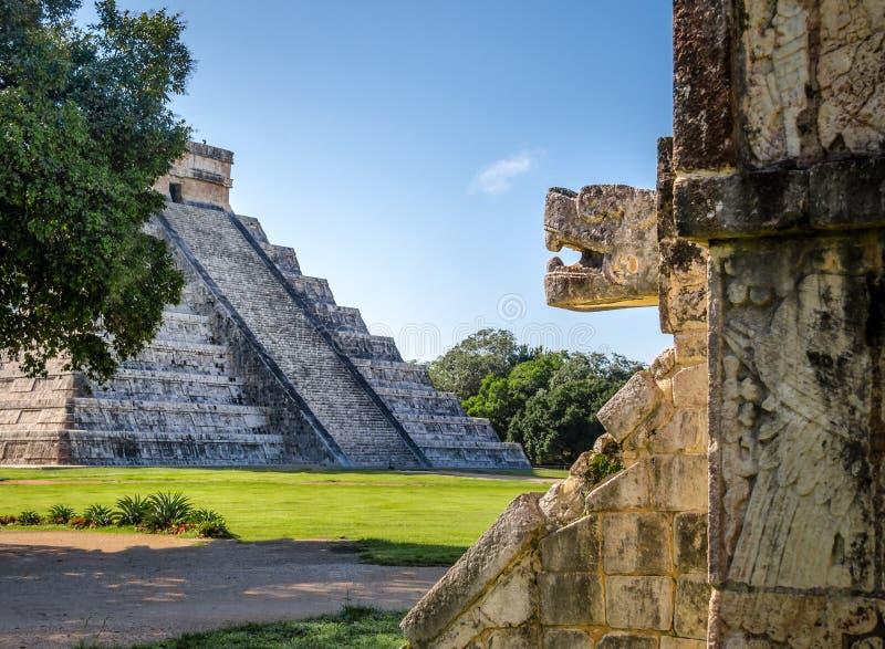 Jaguar head and Mayan Temple pyramid of Kukulkan - Chichen Itza, Mexico stock photo