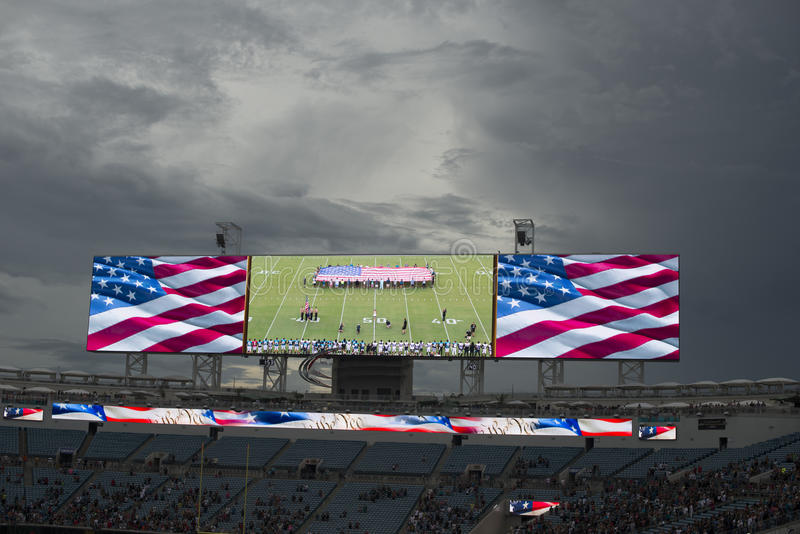 American national anthem performance on huge screen before NFL game. USA flag. The American national anthem performance on huge screen before Jaguars NFL game at stock photos
