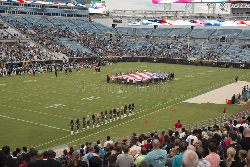 Jaguars NFL game at Everbank field stadium. The American national anthem performance, belly dancers and American flag, before Jaguars NFL game at Everbank field stock image