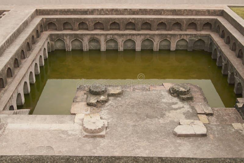 Jahaz Mahal in Mandu, India. Ornate bathing pool at the ancient islamic royal palace of Jahaz Mahal. Mandu, Madhya Pradesh, India. 16th Century AD royalty free stock photos