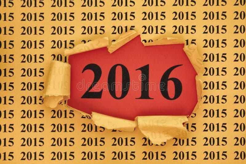 Jahr 2016 erscheint durch das heftige Papier mit 2015-jährigem lizenzfreies stockfoto
